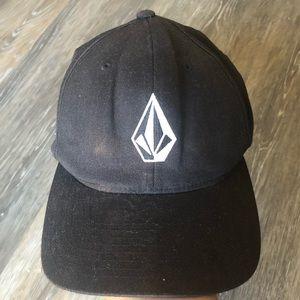 Black Volcom hat.